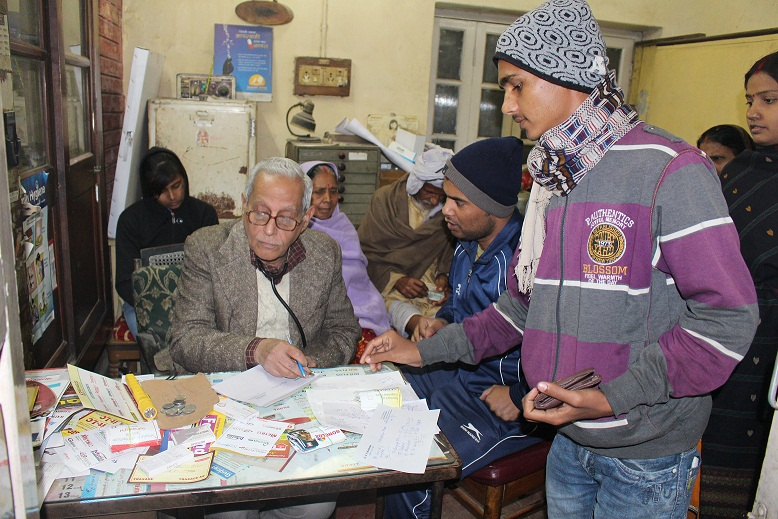 Dr Mukherjee taking 5 rs coin from a patient